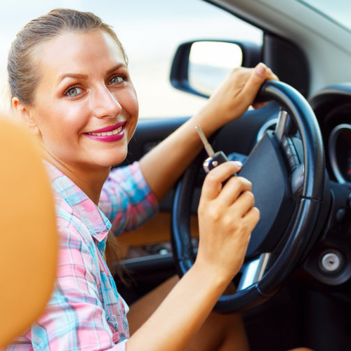 Smiling Woman Starts Her Car